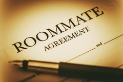 Roommate Agreement Signing Stock Images