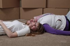 Roommates moving Stock Photos