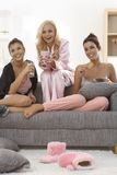 Roommates watching romantic movie at home Stock Photo