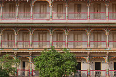Rooms for the devotees. Architectural detail from residential buildings for devotees of the Shri Swaminarayan Hindu sect in Ahmedabad, India stock photography