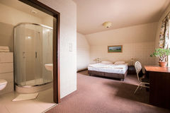 Roomy bedroom and bathroom Stock Photos