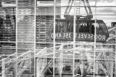 Roosevelt Island cable tramway car reflected in buildings windows. Stock Image