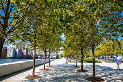 Roosevelt Island Riverwalk. This is a picture of a tree lined riverwalk on Roosevelt Island Royalty Free Stock Image