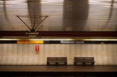 Roosevelt island subway platform. Double bench on an empty roosevelt island subway platform Royalty Free Stock Image