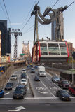 Roosevelt Island Tram in Midair. Roosevelt Island tram in mid air, crossing from Roosevelt Island to Manhattan with Queensboro Bridge in background and cars on Stock Photos
