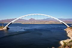 Roosevelt Lake Bridge. In Roosevelt, AZ, is the longest two-lane, single-span, steel-arch bridge in North America.  It crosses the waters of Roosevelt Lake Royalty Free Stock Photography