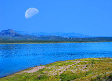 Roosevelt Lake and Moon Royalty Free Stock Photos