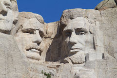 Roosevelt and Lincoln on Mount Rushmore. Theodore Roosevelt and Abraham Lincoln on Mount Rushmore National Monument Stock Image