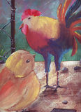 Rooster and chick. The chick looks great by itself: a beautiful colorful rooster Stock Photo