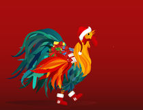 Rooster in costume of Santa Claus brings gifts on Christmas. Vector. Colorful rainbow. Symbol 2017. Blank space for advertising.  Cockerel on a red background Stock Photos