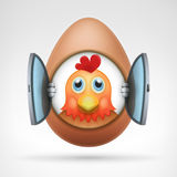 Rooster head in egg with open glass window frame Stock Photo