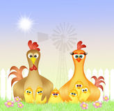 Rooster and hen in the nest Royalty Free Stock Photo