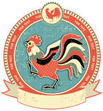 Rooster label on old paper Stock Photo