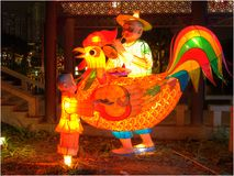 Rooster Lantern, Grandfather playing the flute with grandson royalty free stock photography