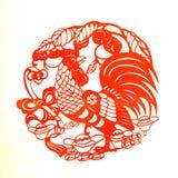 Rooster Lunar year papercut symbol. Papercut of 2017 Chinese Rooster Lunar year symbol Royalty Free Stock Images
