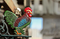 Rooster. Metal decorative rooster statue perched on stand Royalty Free Stock Photo