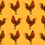 Rooster seamless vector illustration. Rooster vector illustration. Stylized colorful seamless rooster on orange background Royalty Free Stock Photography