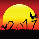 Rooster Silhouette on 2017. Text for Background sunrise. Eps 10 Stock Photo