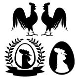 Rooster silhouettes on a white background. Royalty Free Stock Photos