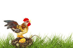 Rooster sitting on an easter nest Stock Image
