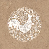 Rooster and snowflakes. Rooster- animal symbol of new year 2017. Vector illustration in the circle on kraft paper,  isolated eleme Royalty Free Stock Images