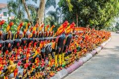 Rooster statues offerings Wat Yai Chai Mongkhon Ayutthaya bangko Stock Image