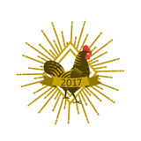 Rooster with sunburst. Engraving style. Stock Images