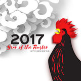 Rooster symbol on the Chinese calendar. 2017 New Year. Rooster, 2017 New Year symbol on the Chinese calendar. Paper cut style Silhouette of black cock and clouds Stock Images