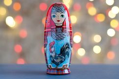 Rooster - a symbol of the New year. The picture on the doll matr royalty free stock image