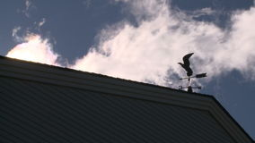 Rooster weather vane (3 of 3). A view or scene from around town stock video footage