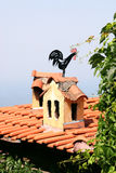 Rooster weathervane on the roof Royalty Free Stock Image