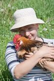 Rooster and woman Stock Photos