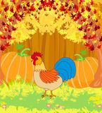 Rooster on wooden background with leaves. Royalty Free Stock Photos
