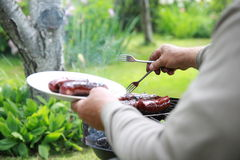 Roosteren die - op de grill roosteren Royalty-vrije Stock Afbeelding