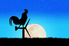 Roosters crow stand on a wind turbine. In the morning Royalty Free Stock Photo