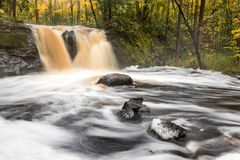 Root Beer Falls near Wakefiled Michigan. Root Beer Falls in Michigan`s Upper Peninsula flows with tannin colored waters royalty free stock image
