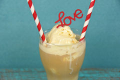 Root beer float with striped straws Royalty Free Stock Images