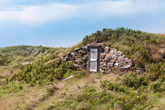 Root cellar wooden entry door Elliston NL Canada Royalty Free Stock Photos
