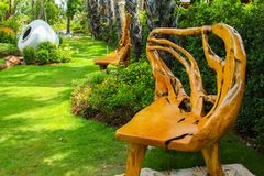 Root Chair in park. Big jar beautiful stock photography