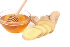 Root Ginger sliced and bow of honey. Stock Photo