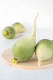 Root green radish on wooden board Royalty Free Stock Photos