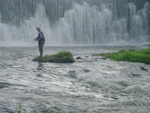 Root river fishing. A lone fisherman on Minnesota's Root River Stock Photos