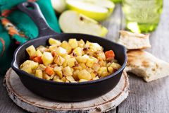 Root vegetable hash with apple. Potato and carrots Stock Images