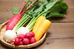 Root vegetables on a bamboo colander. Pictured root vegetables on a bamboo colander Royalty Free Stock Photo