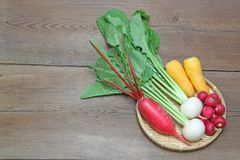 Root vegetables on a bamboo colander. Pictured root vegetables on a bamboo colander Stock Photo