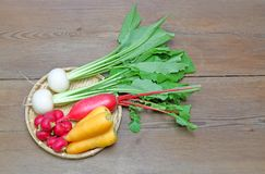 Root vegetables on a bamboo colander. Pictured root vegetables on a bamboo colander Royalty Free Stock Photos