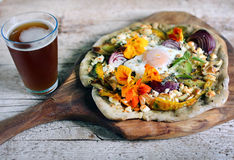 Root vegetables pizza with cottage cheese, egg and flowers Royalty Free Stock Photo
