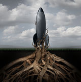 Rooted Down. Concept with an aging rocket ship being held down by growing tree roots as a metaphor for uncompetitive and abandoned strategy of past forgotten Stock Photography