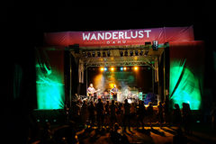 Roothub performs on stage as crowd watches during a evening conc Royalty Free Stock Image