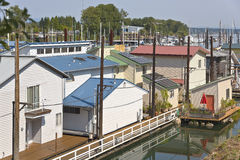 Rootops and floating houses in a marina. Stock Photos